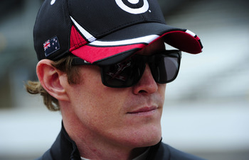 INDIANAPOLIS, IN - MAY 27:  Scott Dixon of New Zealand, driver of the #9 Target Chip Ganassi Racing Dallara Honda, looks on during final practice on Carb Day for the 95th running of the Indianapolis 500 on May 27, 2011 at Indianapolis Motor Speedway in In
