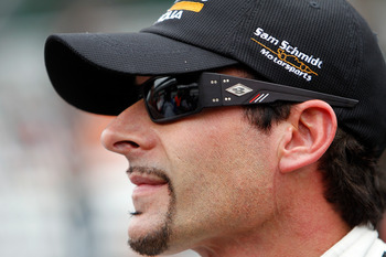 INDIANAPOLIS, IN - MAY 27:  Pole sitter Alex Tagliani, driver of the #77 Bowers &amp; Wilkins/ Sam Schmidt Motorsports Dallara Honda, looks on during final practice on Carb Day for the the 95th Indianapolis 500 Mile Race at the Indianapolis Motor Speedway on