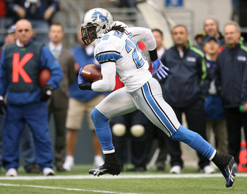 SEATTLE - NOVEMBER 08:  Safety Louis Delmas #26 of the Detroit Lions returns an interception for 29 yards against the Seattle Seahawks on November 8, 2009 at Qwest Field in Seattle, Washington. The Seahawks defeated the Lions 32-20. (Photo by Otto Greule