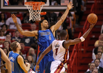 MIAMI, FL - DECEMBER 20:  Chris Bosh #1 of the Miami Heat shoots over Tyson Chandler #6 of the Dallas Mavericks during a game at American Airlines Arena on December 20, 2010 in Miami, Florida. NOTE TO USER: User expressly acknowledges and agrees that, by