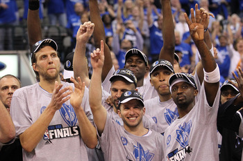 DALLAS, TX - MAY 25:  Dirk Nowitzki #41, Jose Juan Barea #11 and Jason Terry #31 and the Dallas Mavericks celebrate their 100-96 victory against the Oklahoma City Thunder in Game Five of the Western Conference Finals during the 2011 NBA Playoffs at Americ