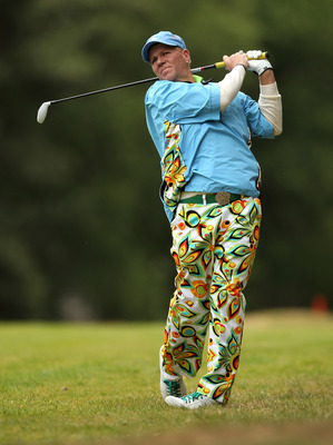 VIRGINIA WATER, ENGLAND - MAY 27:  John Daly of the USA hits an approach shot during the second round of the BMW PGA Championship at the Wentworth Club on May 27, 2011 in Virginia Water, England.  (Photo by Ian Walton/Getty Images)