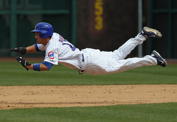 CHICAGO, IL - MAY 06: Darwin Barney #15 of the Chicago Cubs dives into 2nd base for a steal against the Cincinnati Reds at Wrigley Field on May 6, 2011 in Chicago, Illinois. (Photo by Jonathan Daniel/Getty Images)