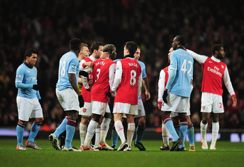 LONDON, ENGLAND - JANUARY 05:  Referee Mike Jones sends off Pablo Zabaleta of Manchester City and Bacary Sagna of Arsenal during the Barclays Premier League match between Arsenal and Manchester City at the Emirates Stadium on January 5, 2011 in London, En