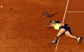 ROME, ITALY - MAY 14:  Maria Sharapova of Russia falls during her semi final match against Caroline Wozniacki of Denmark during day seven of the Internazoinali BNL D'Italia at the Foro Italico Tennis Centre  on May 14, 2011 in Rome, Italy.  (Photo by Cliv