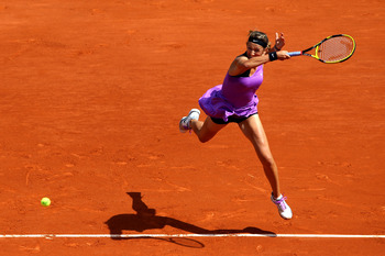 PARIS, FRANCE - MAY 28:  Victoria Azarenka of Belarus hits a forehand during the women's singles round three match between Roberta Vinci of of Italy and Victoria Azarenka of Belarus on day seven of the French Open at Roland Garros on May 28, 2011 in Paris