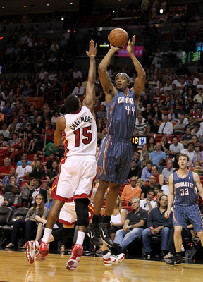 MIAMI, FL - APRIL 08:  Dante Cunningham #44 of the Charlotte Bobcats shoots over Mario Chalmers #15 of the Miami Heat during a game at American Airlines Arena on April 8, 2011 in Miami, Florida. NOTE TO USER: User expressly acknowledges and agrees that, b