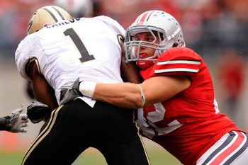 COLUMBUS, OH - OCTOBER 23:  Running back Keith Carlos #1 of the Purdue Boilermakers is tackled by Andrew Sweat #42 of the Ohio State Buckeyes at Ohio Stadium on October 23, 2010 in Columbus, Ohio.  (Photo by Jamie Sabau/Getty Images)