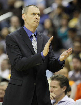 WASHINGTON, DC - FEBRUARY 26:  Rick Carlisle head coach of the Dallas Mavericks applauds his team during a game against the Washington Wizards at the Verizon Center on February 26, 2011 in Washington, DC. NOTE TO USER: User expressly acknowledges and agre