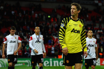 LONDON, ENGLAND - MAY 28: Edwin van der Sar of Manchester United shows his dejection after the UEFA Champions League final between FC Barcelona and Manchester United FC at Wembley Stadium on May 28, 2011 in London, England.  (Photo by Laurence Griffiths/G
