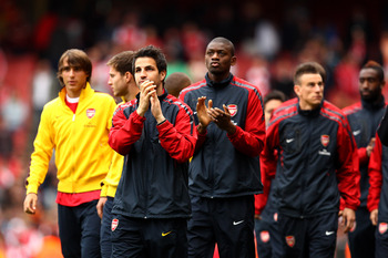 LONDON, ENGLAND - MAY 15:  Cesc Fabregas of Arsenal applauds the fans as he joins his team mates in a lap of honour after the Barclays Premier League match between Arsenal and Aston Villa at the Emirates Stadium on May 15, 2011 in London, England.  (Photo