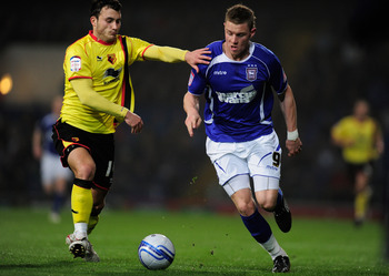 IPSWICH, ENGLAND - MARCH 15:  Connor Wickham of Ipswich Town battles with Will Buckley of Watford during the npower Championship match between Ipswich Town and Watford at Portman Road on March 15, 2011 in Ipswich, England.  (Photo by Jamie McDonald/Getty