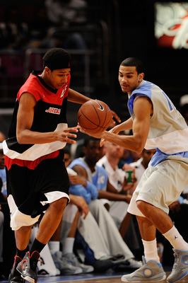 NEW YORK - APRIL 17:  Jelan Kendrick #45 of East team and Cory Joseph #15 of West Team reach for the ball during the National Game at the 2010 Jordan Brand classic at Madison Square Garden on April 17, 2010 in New York City.  (Photo by Jeff Zelevansky/Get
