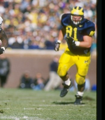 16 Nov 1996:  Tailback Curtis Enis of the Penn State Nittany Lions runs down the field during a game against the Michigan Wolverines at Michigan Stadium in Ann Arbor, Michigan.  Penn State won the game 23-17. Mandatory Credit: Brian Bahr  /Allsport