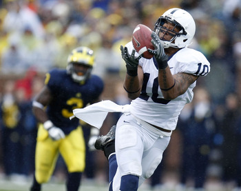 ANN ARBOR, MI - OCTOBER 24: Andrew Quarless #10 of the Penn State Nittany Lions catches a second quarter touchdown pass in front of Stevie Brown #3 of the Michigan Wolverines on October 24, 2009 at Michigan Stadium in Ann Arbor, Michigan.  (Photo by Grego