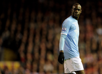 LIVERPOOL, ENGLAND - APRIL 11:  Mario Balotelli of Manchester City looks on during the Barclays Premier League match between Liverpool and Manchester City at Anfield on April 11, 2011 in Liverpool, England. (Photo by Michael Regan/Getty Images)