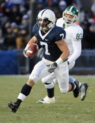 STATE COLLEGE - NOVEMBER 22:  Anthony Scirrotto #7 of the Penn State Nittany Lions returns an interception in front of Charlie Gantt #83 of the Michigan State Spartans on November 22, 2008 at Beaver Stadium in State College, Pennsylvania.  (Photo by Joe S