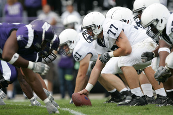 EVANSTON, IL - SEPTEMBER 24:  Center E.Z. Smith #77 of the Penn State Nittany Lions gets set to snap the ball against the Northwestern Wildcats defense September 24, 2005 at Ryan Field in Evanston, Illinois.  Penn State won 34-29.   (Photo by Brian Bahr/G
