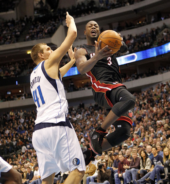 Dirk Nowitzki goes to block Dwyane Wade's shot in their first meeting of the season back in November.