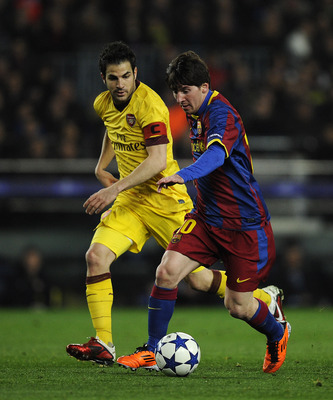 BARCELONA, SPAIN - MARCH 08:  Lionel Messi of FC Barcelona (R) duels for the ball against Cesc Fabregas of Arsenal during the UEFA Champions League round of 16 second leg match between Barcelona and Arsenal at the Camp Nou stadium on March 8, 2011 in Barc