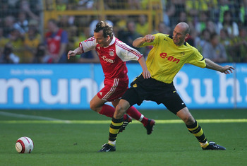 DORTMUND, GERMANY - SEPTEMBER 18:  Jen Jeremies of Munich in action against Jan Koller of Dortmund during The Bundesliga match between Borussia Dortmund and Bayern Munich at The Westfallen Stadium on September 18, 2004 in Dortmund, Germany.  (Photo by Stu