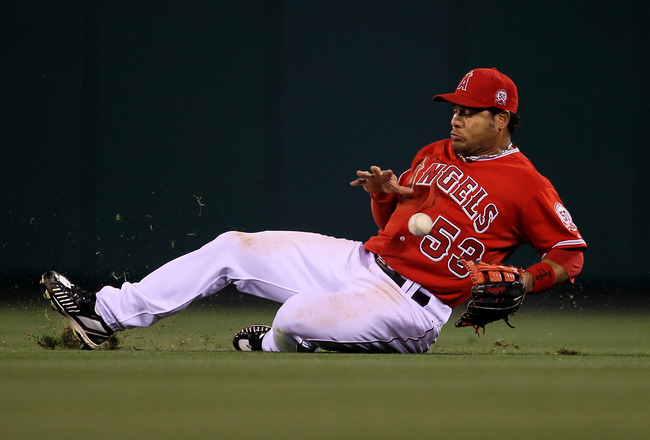 ANAHEIM, CA - APRIL 23:  Right fielder Bobby Abreu #53 of the Los Angeles Angels of Anaheim slides back can't reach a single hit by J.D. Drew of the Boston Red Sox on April 23, 2011 at Angel Stadium in Anaheim, California.    (Photo by Stephen Dunn/Getty
