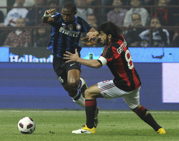 MILAN, ITALY - APRIL 02: (L - R) Samuel Eto'o of Inter competes with Gennaro Gattuso of Milan during the Serie A match between AC Milan and FC Internazionale Milano at Stadio Giuseppe Meazza on April 2, 2011 in Milan, Italy.  (Photo by Dino Panato/Getty I
