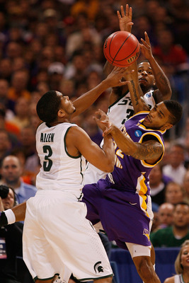 ST. LOUIS - MARCH 26: Chris Allen #3 and Korie Lucious #34 both of the Michigan State Spartans look to out rebound Anthony James #52 of the Northern Iowa Panthers during the midwest regional semifinal of the 2010 NCAA men's basketball tournament at the Ed