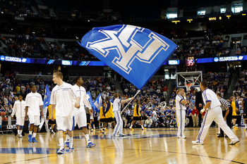 TAMPA, FL - MARCH 19:  A cheerleader from the Kentucky Wildcats waves a giant UK flag as the team warms up prior to playing against the West Virginia Mountaineers during the third round of the 2011 NCAA men's basketball tournament at St. Pete Times Forum