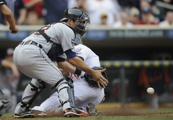 MINNEAPOLIS, MN - MAY 11: Ben Revere #11 of the Minnesota Twins slides safely into home plate as Alex Avila #13 of the Detroit Tigers defends during in the eighth inning of their game on May 11, 2011 at Target Field in Minneapolis, Minnesota. Tigers defea