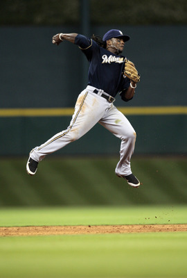 HOUSTON - APRIL 30: Second baseman Rickie Weeks #23 of the Milwaukee Brewers makes a leaping throw to first base against the Houston Astros at Minute Maid Park on April 30, 2011 in Houston, Texas.  (Photo by Bob Levey/Getty Images)