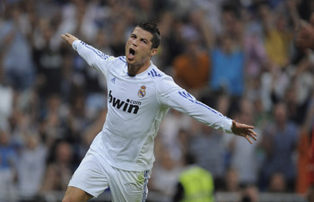 MADRID, SPAIN - MAY 21:  Cristiano Ronaldo of Real Madrid celebrates after scoring his second goal during the La Liga match between Real Madrid and UD Almeria at Estadio Santiago Bernabeu on May 21, 2011 in Madrid, Spain.  (Photo by Denis Doyle/Getty Imag