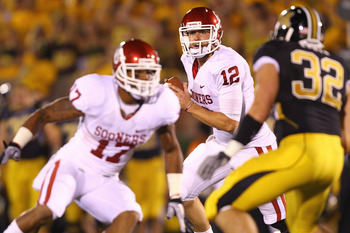 COLUMBIA, MISSOURI - OCTOBER 23: Landry Jones #12 of the Oklahoma Sooners looks to pass the ball against the Missouri Tigers at Faurot Field/Memorial Stadium on October 23, 2010 in Columbia, Missouri.  (Photo by Dilip Vishwanat/Getty Images)
