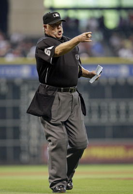 HOUSTON,TX- APRIL 10 :  Home plate Umpire Jim Joyce gives warnings to the of the Houston Astros and  the Florida Marlins bench in a MLB  baseball game on April 10, 2011 at Minute Maid Park in Houston, Texas. (Photo by Thomas B. Shea / Getty Images)
