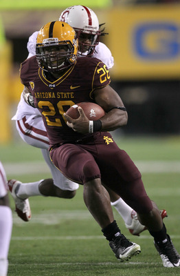 TEMPE, AZ - NOVEMBER 13:  Running back Cameron Marshall #26 of the Arizona State Sun Devils carries the ball against cornerback Richard Sherman #9 of the Stanford Cardinal at Sun Devil Stadium on November 13, 2010 in Tempe, Arizona.  (Photo by Stephen Dun