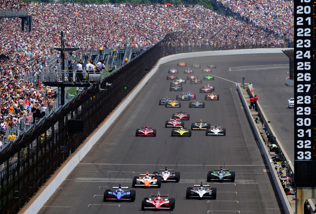 INDIANAPOLIS, IN - MAY 29:  Scott Dixon of New Zealand, driver of the #9 Target Chip Ganassi Racing Dallara Honda, leads the field during the IZOD IndyCar Series Indianapolis 500 Mile Race at Indianapolis Motor Speedway on May 29, 2011 in Indianapolis, In