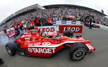 INDIANAPOLIS, IN - MAY 27:  Dario Franchitti of Scotland, driver of the #10 Target Chip Ganassi Racing Dallara Honda, competes during the IZOD Pit Stop Challenge on Carb Day for the 95th running of the Indianapolis 500 on May 27, 2011 at the Indianapolis