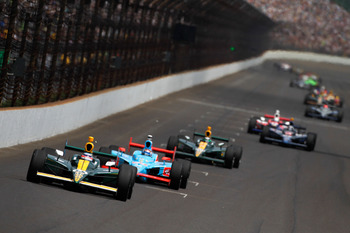 INDIANAPOLIS, IN - MAY 29:  Takuma Sato of Japan, driver of the #5 Lotus KV Racing Technologies Dallara Honda, leads a line of cars during the IZOD IndyCar Series Indianapolis 500 Mile Race at Indianapolis Motor Speedway on May 29, 2011 in Indianapolis, I