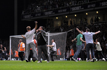 LONDON, ENGLAND - AUGUST 25:  Fans invade the pitch during the Carling Cup second round match between West Ham United and Millwall at Upton Park on August 25, 2009 in London, England.  . Violence broke out between West Ham and Millwall supporters, prior t