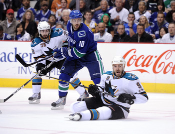 VANCOUVER, CANADA - MAY 18:  Jeff Tambellini #10 of the Vancouver Canucks and Benn Ferriero #78 and Ian White #9 of the San Jose Sharks follow the play in Game Two of the Western Conference Finals during the 2011 Stanley Cup Playoffs at Rogers Arena on Ma