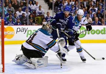 VANCOUVER, CANADA - MAY 24:  Joe Pavelski #8 of the San Jose Sharks defends Henrik Sedin #33 of the Vancouver Canucks as goaltender Antti Niemi #31 of the San Jose Sharks makes a save in Game Five of the Western Conference Finals during the 2011 Stanley C