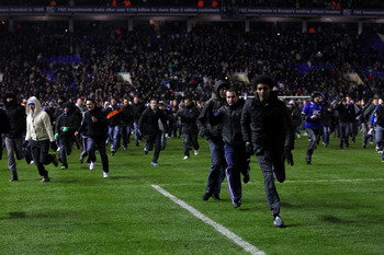 BIRMINGHAM, ENGLAND - DECEMBER 01:  Birmingham fans are chased off the pitch by police after the Carling Cup Quarter Final between Birmingham City and Aston Villa at St Andrews on December 1, 2010 in Birmingham, England.  (Photo by Stu Forster/Getty Image