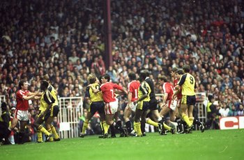 20 Oct 1990:  Manchester United and Arsenal players fight on the pitch during the Barclays League Division One match at Old Trafford in Manchester, England. Arsenal won the match 1-0. \ Mandatory Credit: Russell  Cheyne/Allsport