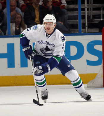 ATLANTA, GA - MARCH 25:  Christian Ehrhoff #5 of the Vancouver Canucks skates against the Atlanta Thrashers at the Philips Arena on March 25, 2011 in Atlanta, Georgia.  (Photo by Bruce Bennett/Getty Images)