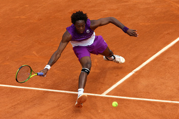 PARIS, FRANCE - MAY 27:  Gael Monfils of France stretches to hit a forehand during the men's singles round three match between Steve Darcis of Belgium and Gael Monfils of France on day six of the French Open at Roland Garros on May 27, 2011 in Paris, Fran