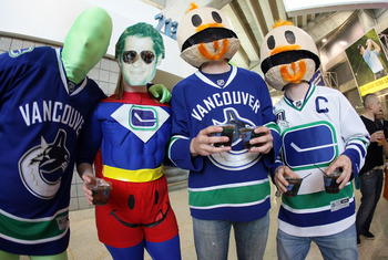 SAN JOSE, CA - MAY 20:  Fans of the Vancouver Canucks in costume show their support prior to Game Three of the Western Conference Finals between the Vancouver Canucks and the San Jose Sharks during the 2011 Stanley Cup Playoffs at HP Pavilion on May 20, 2