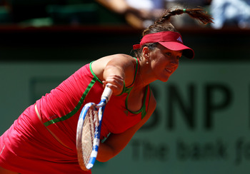 PARIS, FRANCE - MAY 29:  Anastasia Pavlyuchenkova of Russia serves during the women's singles round four match between Vera Zvonareva of Russia and Anastasia Pavlyuchenkova of Russia on day eight of the French Open at Roland Garros on May 29, 2011 in Pari
