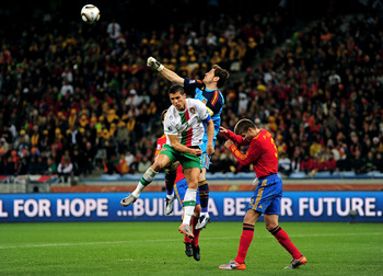 CAPE TOWN, SOUTH AFRICA - JUNE 29:  Iker Casillas of Spain defends an attack by Cristiano Ronaldo of Portugal during the 2010 FIFA World Cup South Africa Round of Sixteen match between Spain and Portugal at Green Point Stadium on June 29, 2010 in Cape Tow
