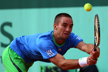PARIS, FRANCE - MAY 26:  Viktor Troicki of Serbia hits a backhand during the men's singles round two match between Tobias Kamke of Germany and Viktor Troicki of Serbia on day five of the French Open at Roland Garros on May 26, 2011 in Paris, France.  (Pho