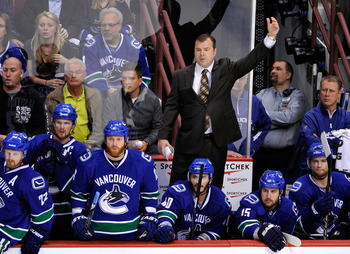 VANCOUVER, CANADA - MAY 24:   Head Coach Alain Vigneault of the Vancouver Canucks waves in goaltender Roberto Luongo #1 for the extra attacker late in the third period in Game Five of the Western Conference Finals against the San Jose Sharks during the 20